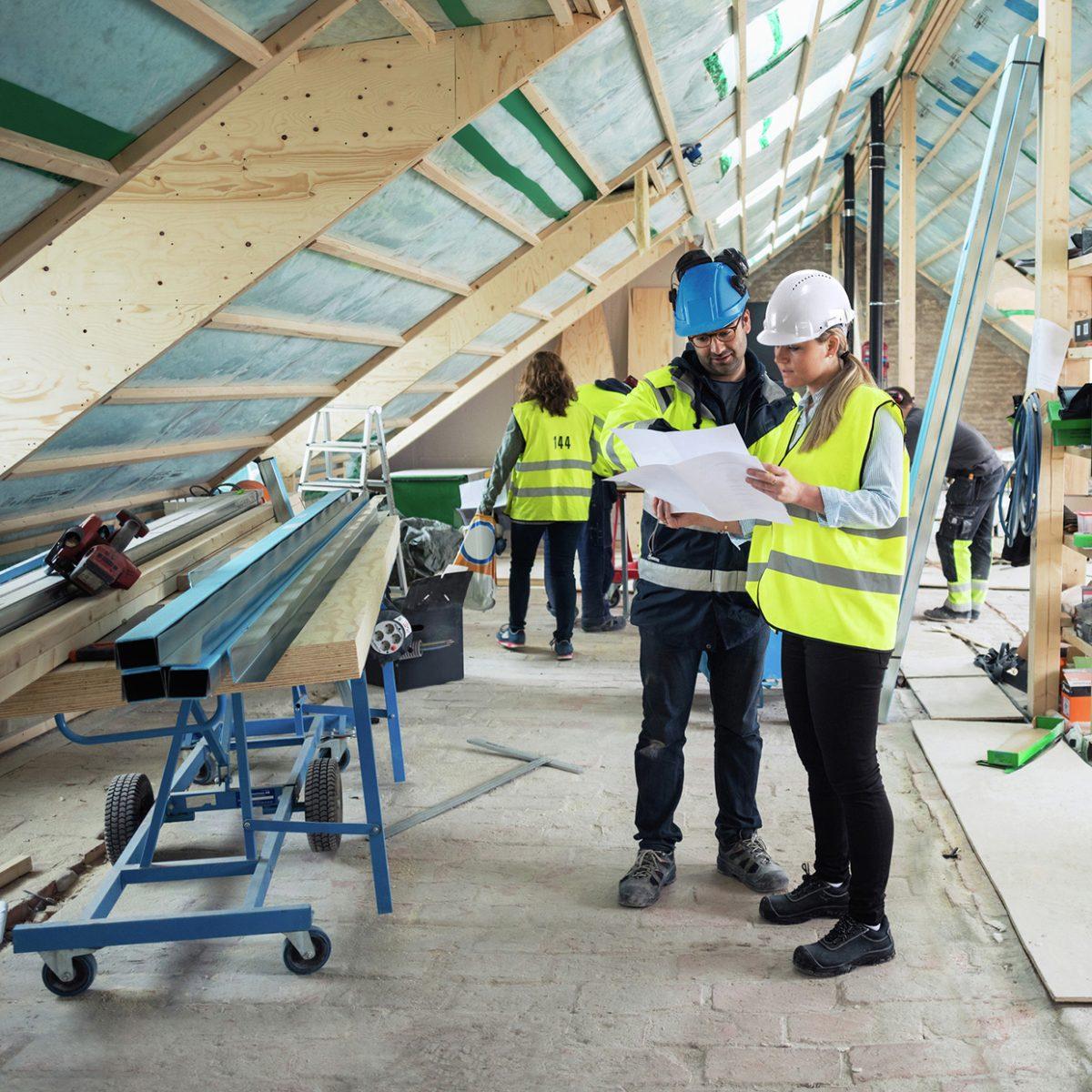 a work team planning repairs