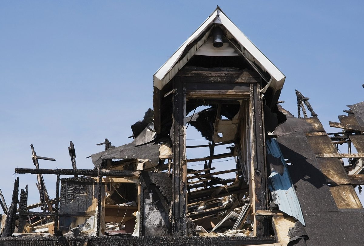 The charred remains of a fire-damaged home.