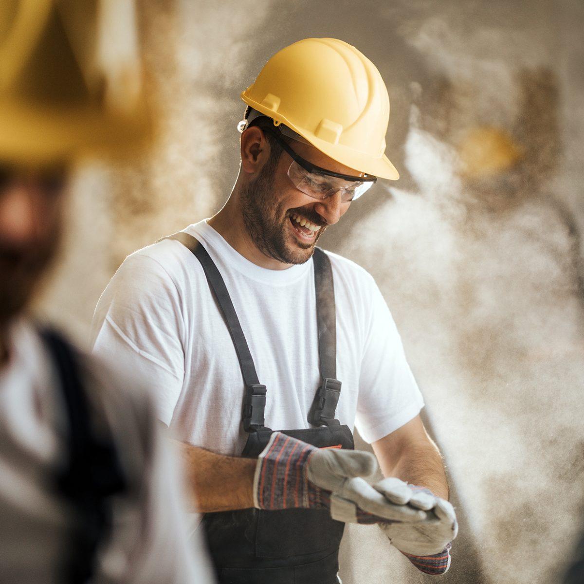 Workmen on site in hard hats.
